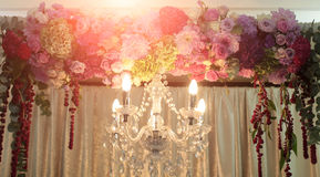 Cut-glass chandelier and decorated arch Stock Photography