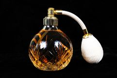 Cut glass perfume atomiser bottle. Stock Image