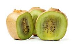 Cut golden kiwifruit/ kiwi (Actinidia chinensis). On white background Royalty Free Stock Photos