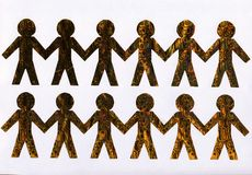 Cut from Golden paper people on white background royalty free stock photos