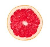 Cut grapefruit. A section of ripe juicy grapefruit on white background. Isolation Stock Photos