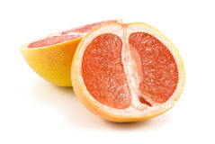 The cut grapefruit Stock Images