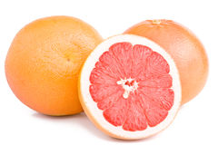 A cut of grapefruit. Grapefruits and cut a fruit isolated on the white Royalty Free Stock Photography