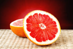 Cut grapefruit closeup Royalty Free Stock Photo