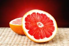 Cut grapefruit closeup Royalty Free Stock Photo