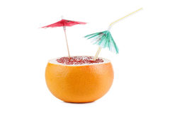 Cut grapefruit cocktail with umbrella, isolated on white Royalty Free Stock Image