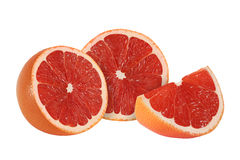 Cut grapefruit fruits  on white. Background Royalty Free Stock Photo