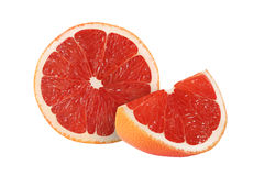 Cut grapefruit fruits  on white. Background Royalty Free Stock Photography