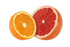 Cut grapefruit and orange fruits  on white. Background Royalty Free Stock Image