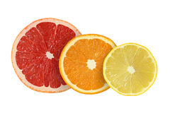 Cut grapefruit and orange and lemon fruits. On white background Stock Photos