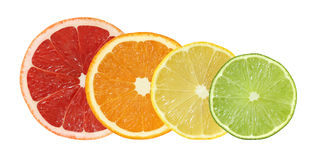 Cut grapefruit, orange, lemon and lime fruits isolated. On white background Stock Images