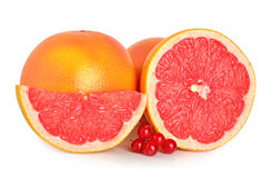 Cut grapefruits and berry Royalty Free Stock Photography