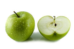 Cut green apple Stock Images