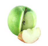 Cut green apple with red piece Royalty Free Stock Photo
