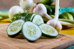 The cut green cucumber with garlic Royalty Free Stock Images