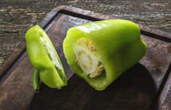 Cut green pepper on wood Stock Images
