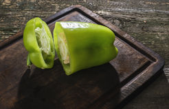 Cut green pepper on wood Royalty Free Stock Photos