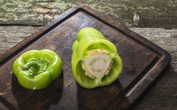 Cut green pepper on wood Stock Photography