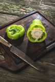 Cut green pepper on wood Stock Image