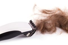 Cut hair with clipper. Isolated on white background stock images