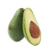 Cut in half avocado fruit composition Stock Photos