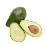 Cut in half avocado fruit composition Stock Images