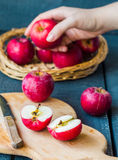 Cut in half fresh red apples on a wooden board, fruits Royalty Free Stock Images