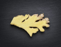 Cut in half ginger  on dark stone slab. Stock Photo