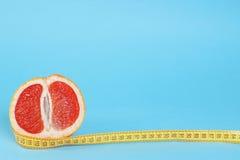 Cut half of grapefruit with meter Stock Image