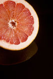 Cut half of juicy ripe grapefruit Royalty Free Stock Photos