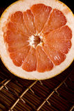 Cut half of juicy ripe grapefruit Royalty Free Stock Images