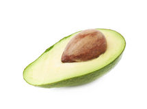 Cut in half open avocado fruit. Cut in half open ripe avocado fruit with the pit, isolated over the white background Stock Images