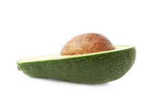 Cut in half open avocado fruit Stock Photos