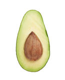 Cut in half open avocado fruit. Cut in half open ripe avocado fruit with the pit, isolated over the white background Royalty Free Stock Image
