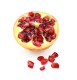 Cut half pomegranate with seeds removed Royalty Free Stock Photography