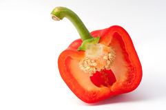 Cut half of red pepper. Red pepper cut in half with the seeds still in place Royalty Free Stock Image