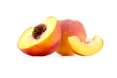 Cut in half with a slice of peach close-up isolated on white Stock Photos
