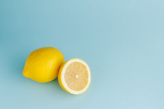 Cut half and whole lemons Royalty Free Stock Photos