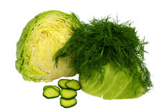 Cut in half young cabbage with a sprig of dill and chopped cucumber on white Royalty Free Stock Photography