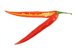 Cut in halves chili pepper isolated Royalty Free Stock Photo