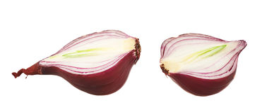 Cut in halves red onion isolated Royalty Free Stock Images