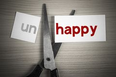 Cut happy from unhappy Stock Photo