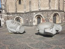 Cut heads. Sculpture of severed heads near bonn cathedral in germany royalty free stock photos