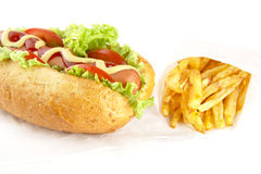 Cut image-classic hotdog with chips on serviette on white Royalty Free Stock Photography