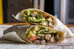 Cut indian wrap with chicken meat and garam masala Stock Image