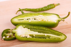 Cut Jalapeno and Whole Cayenne Peppers Stock Images