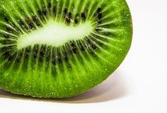 Cut juicy kiwi close-up on a white background stock photos