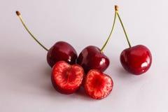 Cut juicy red cherries Stock Photo