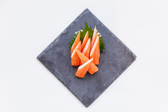 Cut Kani Crab Stick Sashimi Served with Sliced Radish on Stone Plate Stock Photos