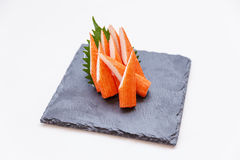 Cut Kani Crab Stick Sashimi Served with Sliced Radish on Stone Plate Stock Photography